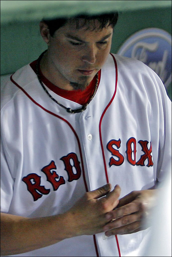 Josh Beckett feels his finger in the dugout after finishing his night's work after the seventh inning.