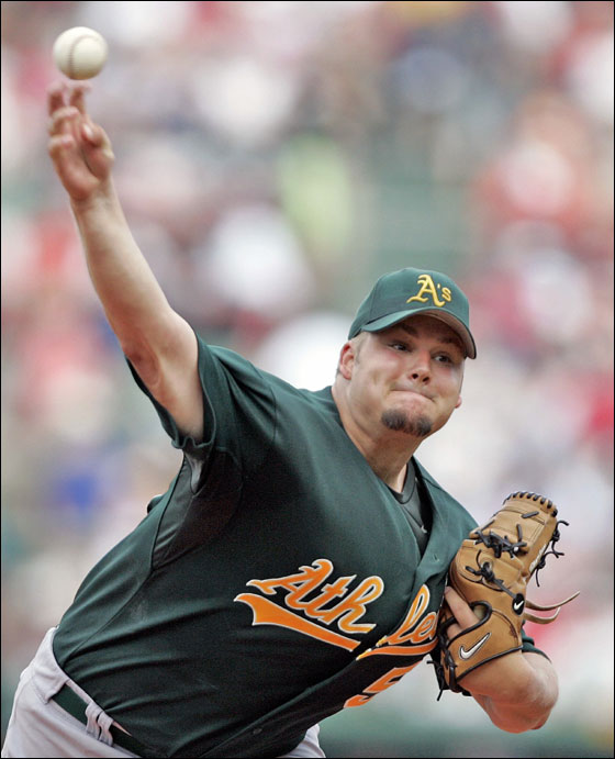 Oakland Athletics Joe Blanton pitches against the Boston Red Sox during the first inning of their MLB baseball game at Fenway Park in Boston, Massachusetts July 16
