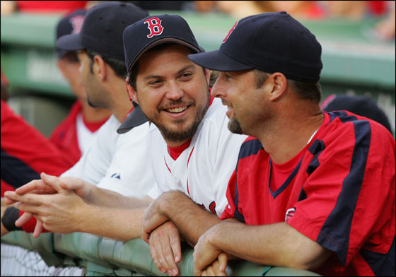 Josh Beckett No. 19 and Tim Wakefield No. 49 of the Red Sox have a laugh before playing the New York Mets on June 27, 2006 at Fenway Park in Boston.
