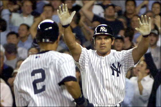 New York Yankees Johnny Damon, center, greets Derek Jeter at home plate as Detroit Tigers catcher Ivan Rodriguez watches during the sixth inning in Game 1 of Major League Baseball's American League Division Series Tuesday, Oct. 3, 2006 at Yankee Stadium in New York. Damon and Jeter scored on a base hit by Bobby Abreu.