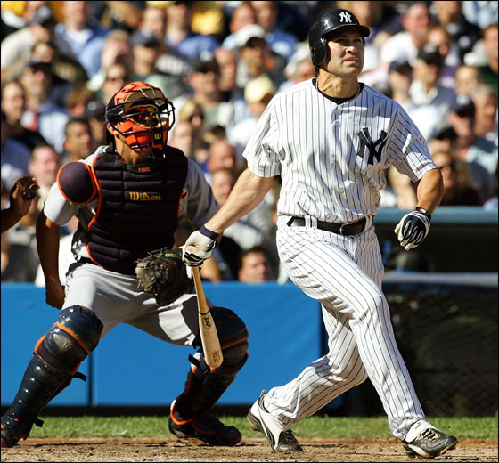 Johnny Damon #18 of the New York Yankees watches his ball after hitting a three-run home run in the fourth inning of Game Two of the American League Division Series against the Detroit Tigers on October 5, 2006 at Yankee Stadium in the Bronx Borough of New York City.