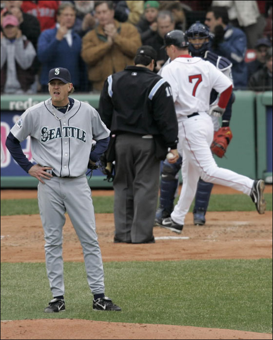 Seattle Mariner's starter Jeff Weaver looks toward the outfield as Boston Red Sox' J.D. Drew (7) crosses home plate on his two-run homer during the second inning of their baseball game in Boston, Tuesday, April 10, 2007. Weaver gave up seven runs on seven hits in his two inning outing.