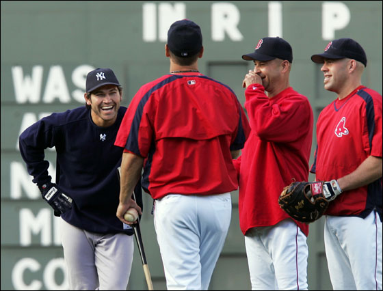 Current New York Yankees outfielder and former Boston Red Sox player, Johnny Damon, left, laughs while talking to Boston Red Sox coach Bill Haselman, second left, manager Terry Francona, and infielder Kevin Youkilis, right, prior to their baseball game at Fenway Park in Boston Monday, May 22, 2006