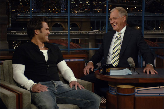 New York Yankees star Johnny Damon, right, talks with David Letterman on the set of the 'Late Show with David Letterman, Monday, April 10, 2006. (