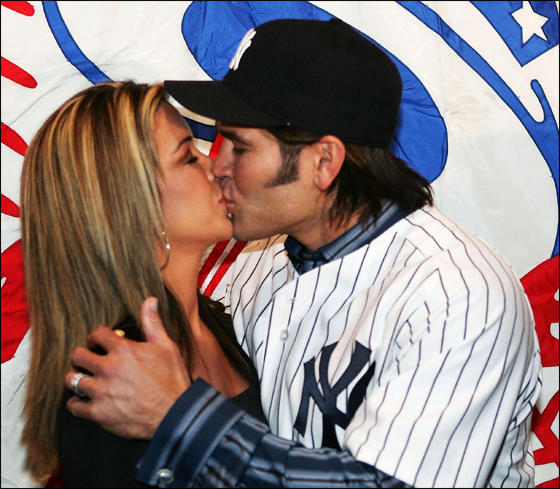 Johnny Damon of the New York Yankees kisses his wife Michelle after being introduced as the new center fielder on December 23, 2005 at Yankee Stadium in the Bronx Borough of New York City.