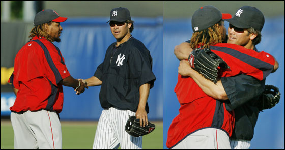 Boston Red Sox left fielder Manny Ramirez and New York Yankees center fielder Johnny Damon embrace on the field, Wednesday, March 22, 2006, before a spring baseball game between the the Yankees and the Red Sox at Legends Field in Tampa, Fla. The pair are former teammates.