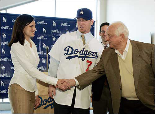 Dec. 2004: Los Angeles Dodgers icon and senior vice president Tommy Lasorda, right, greets Sheigh Drew, left, wife of new Dodgers outfielder J.D. Drew. The Dodgers and Drew finalized a five-year, $55 million deal Thursday in Los Angeles.