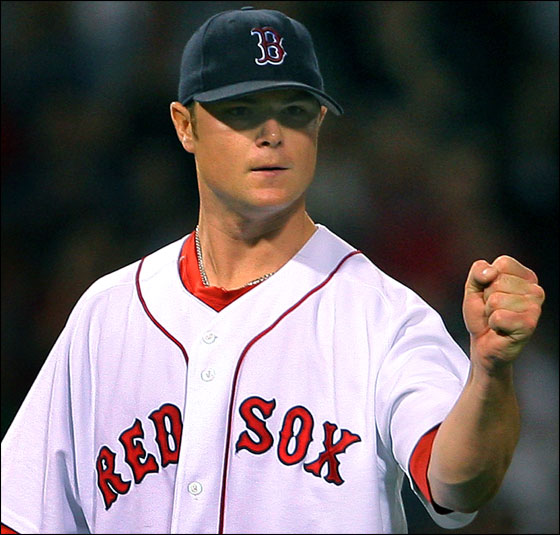 Red Sox starter Jon Lester pumps his fist after getting Mark Teahen to hit into a seventh inning ending double play.