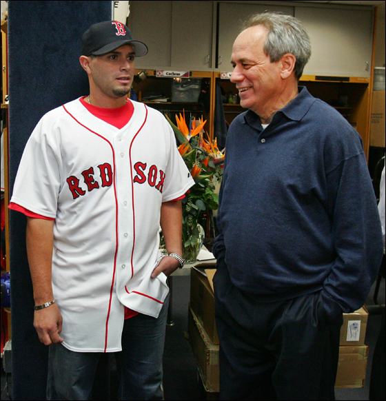 The Red Sox signed pitcher Joel Pineiro, left to a one year contract as he talks to Larry Lucchino (CEO/President) before a press conference in the Red Sox Clubhouse on Thursday January 4, 2007.