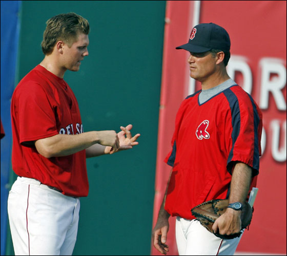 Red Sox pitcher Jonathan Papelbon (left) is leaving the starting rotation and returning to the closer's role. He is shown with pitching coach John Farrell (right) in the outfield at City of Palms Park during Spring Training.