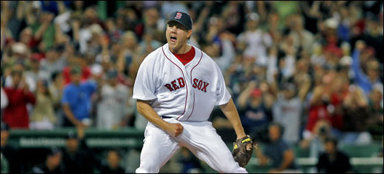 Red Sox closer Jonathan Papelbonhowls as he strikes out Todd Helton swinging to end the game and preserve Tim Wakefield's 2-1 victory over the Rockies.