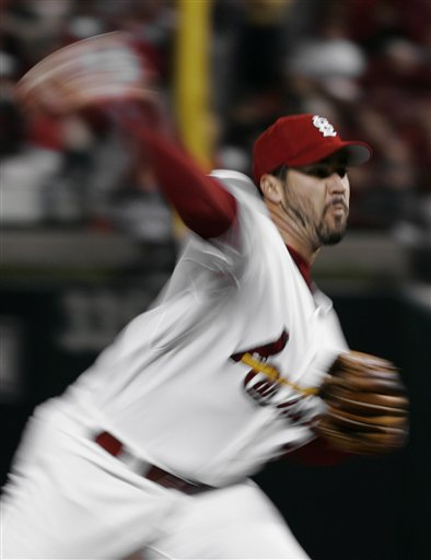 St. Louis Cardinals' Jeff Suppan is a whirl of motion as he pitches against the New York Mets in the third inning of Game 3 of the National League Championship Series Saturday, Oct. 14, 2006, in St. Louis.