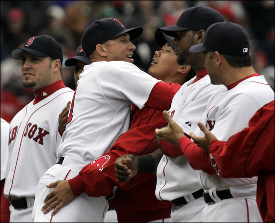 Julian Tavarez greets Sox pitcher Dice-K Matsuzaka during Opening Day ceremonies at Fenway Park