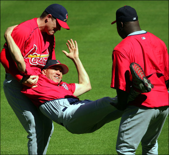 St. Louis Cardinals pitchers Jason Isringhausen, left, and Ray King, right, play a little rough house by carrying  fellow pitcher Julian Tavarez in the infield during a team workout in Houston, Friday, Oct. 15, 2004. The Cardinals, leading the best-of-seven games National League Championship Series 2-0, play the Houston Astros in Game 3 on Saturday, Oct. 16.