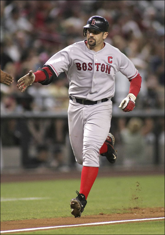 Red Sox Jason Varitek rounds third base after hitting a sixth inning two run homerun against the Arizona Diamondbacks during their MLB interleague baseball game in Phoenix June 9, 2007.