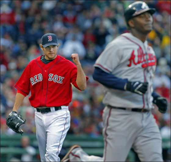 Red Sox pitcher Kason Gabbard (left) pumps his fist after getting out of a two on, two out jam in the fifth inning by getting the Braves' Edgar Renteria to ground out to second to end the threat.