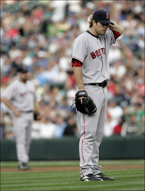 Red Sox starting pitcher Kason Gabbard steps off the mound after walking in a run during the first inning of their American League MLB baseball game against the Seattle Mariners in Seattle