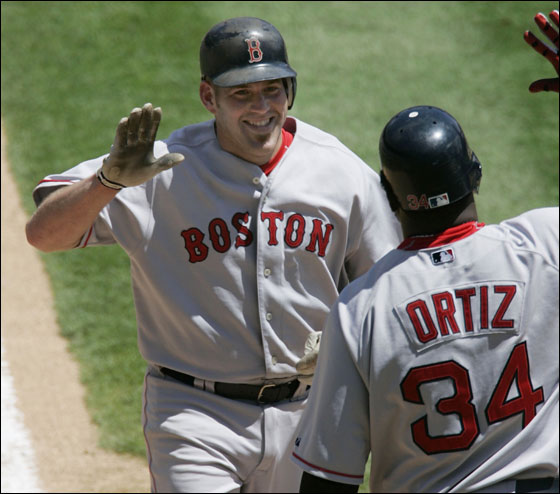 Kevin Youkilis was congratulated at home plate by David Ortiz after hitting a home run in the fifth inning.