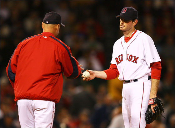 Matt Clement of the Red Sox hands the ball to Manager Terry Francona and leaves the game in the fifth inning against the New York Yankees on May 24, 2006 at Fenway Park in Boston, Massachusetts.