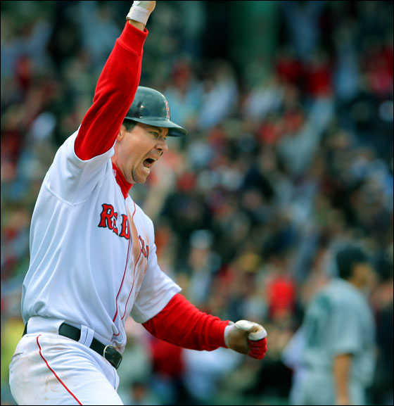 The Red Sox defeated the Seattle Mariners 7-6 at Fenway Park on a bottom of the ninth inning walk off two run home run off the bat of Mark Loretta. Here Loretta celebrates as he rounds first and realizes the ball has cleared the wall. Beaten Mariners closer Eddie Guardado can be seen also watching the flight of the ball at lower right.