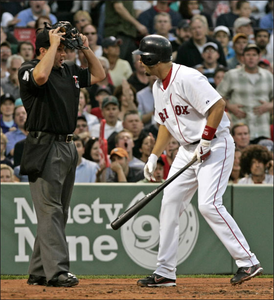 Boston Red Sox 3B Mike Lowell can't believe he is called out on strikes with the bases loaded in the 1st inning.
