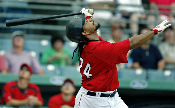 Red Sox slugger Manny Ramirez fouled out during his first at bat in this afternoon's game at City of Palms Park vs. Toronto, here he watches the flight of the ball.