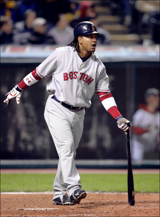 Boston Red Sox slugger Manny Ramirez watches his three-run homer off Cleveland Indians pitcher Guillermo Mota in the eighth inning of a Major League baseball game Tuesday, April 25, 2006, in Cleveland.