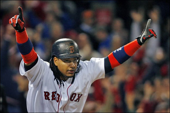 Manny Ramirez won a wild one for the Red Sox tonight with a bottom of the eighth inning solo home run, his second round tripper of the night, as Boston defeated the Mariners 8-7 at Fenway Park. Here he raises his arms in triumph as the crowd goes wild in the backround as the ball sails out of the park.