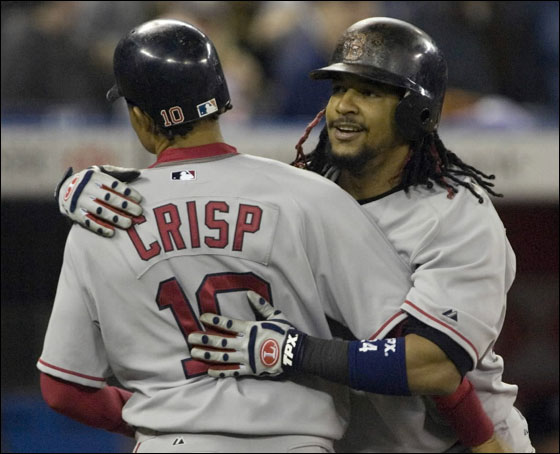 Boston Red Sox Manny Ramirez, right, is greeted by Coco Crisp after hitting a two run homer in the eighth inning to tie the game during AL baseball action against the Toronto Blue Jays in Toronto, Thursday April 19, 2007.