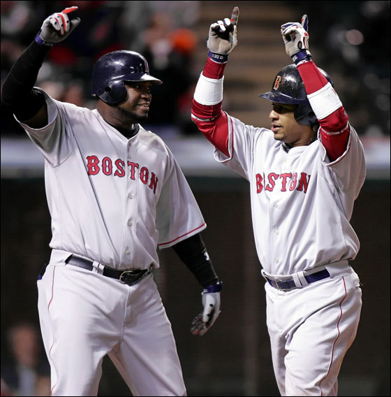 Red Sox's David Ortiz (left) and Manny Ramirez celebrate Ramirez's eighth-inning, three-run homer off Cleveland Indians pitcher Guillermo Mota in a Major League baseball game Tuesday, April 25, 2006, in Cleveland.