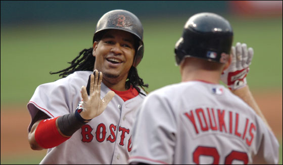 Red Sox Manny Ramirez receives congratulations from Kevin Youkilis after hitting a home run off Cleveland Indians starting pitcher Cliff Lee in the second inning of their MLB American League baseball game in Cleveland, Ohio July 26, 2007.