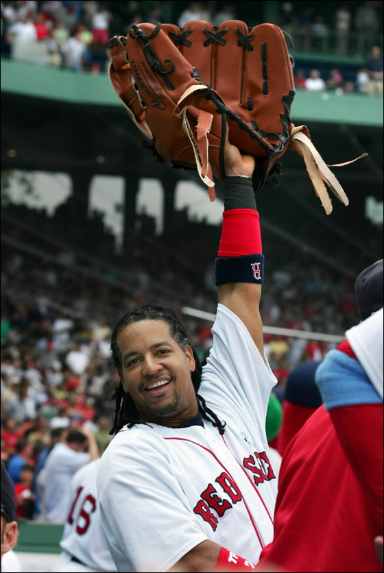 Red Sox Manny Ramirez holding Wally The Green Monster's glove during pregame against the San Francisco Giants at Fenway Park on Sunday June 17, 2007.