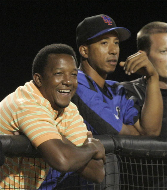 New York Mets' Pedro Martinez, left, watches play against the Boston Red Sox with Damion Easley from the dugout in the sixth inning during a spring training baseball game Thursday, March 15, 2007, in Port St. Lucie, Fla. (AP Photo/Julie Jacobson)