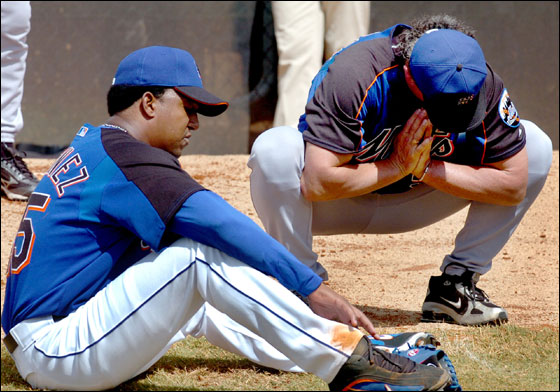 New York Mets pitcher Pedro Martinez, left, takes a break fom a bullpen session and talks about his progress with pitching coach Rick Peterson during a short baseball workout for Martinez Saturday, March 11, 2006 in Port St. Lucie, Fla.