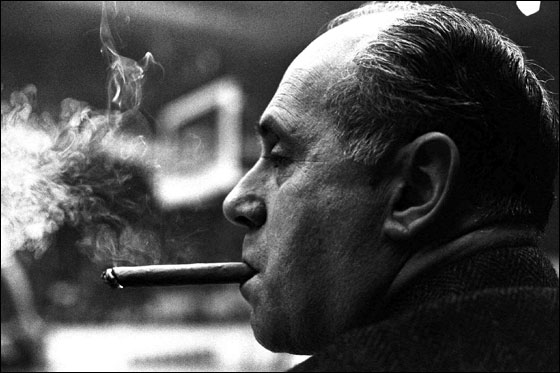 Boston Celtics coach Red Auerbach sits on the bench at Boston Garden smoking a cigar after the Celtics took a commanding lead against the Los Angeles Lakers, securing Auerbach's 1000th NBA victory in Boston, in this Jan. 13, 1966 photo.