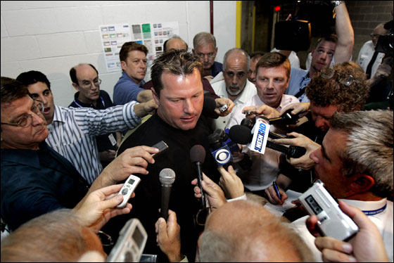 Roger Clemens speaks to reporters after visiting the clubhouse before the season opener against the Boston Red Sox and Texas Rangers in Arlington, Texas, Monday, April 3, 2006.