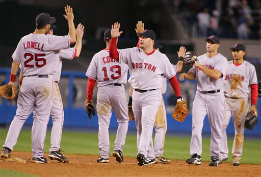 Members of the Boston Red Sox celebrate after defeating the New York Yankees 5-4 in the second game of a double header baseball game, Sunday, Sept. 17, 2006, at Yankee Stadium in New York.