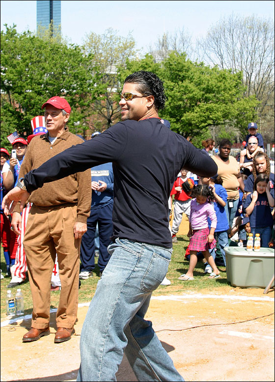 Red Sox pitcher and South End Youth Baseball alumni Manny Delcarmen throws out the first pitch during opening Day ceremonies of the 20th season of South End Youth Baseball at Peters Park in the South End of Boston.