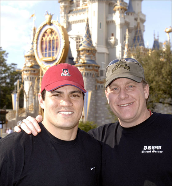 New England Patriots linebacker Tedy Bruschi and Boston Red Sox pitcher Curt Schilling at the Magic Kingdom at Walt Disney World Resort in Lake Buena Vista, Fla., on Wednesday, Feb. 15, 2006.
