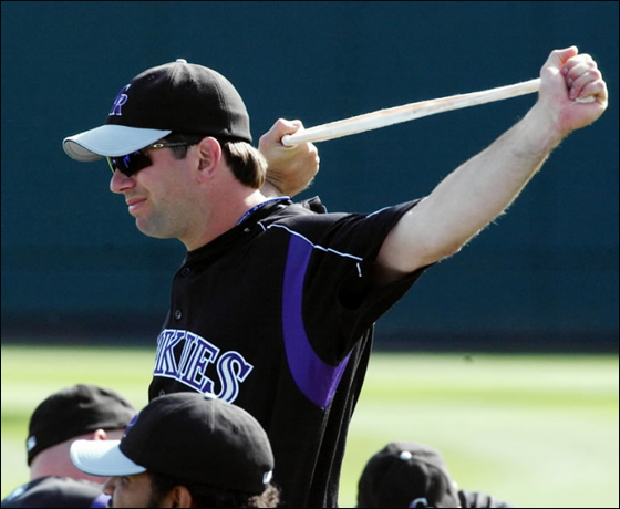 Colorado Rockies first baseman Todd Helton stretches with teammates at the Rockies spring training facility in Tucson, Ariz., on Monday, March 21, 2005. Helton is upset with St. Louis Cardinals broadcaster Wayne Hagin who accused Helton of taking steroids during a broadcast on Saturday.