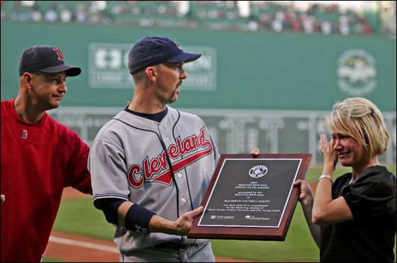 The Boston Red Sox manager Terry Francona present the Cleveland Indians outfielder Trot Nixon and his wife, Kathryn Nixon a plaque for their contributions to the Jimmy Fund before the start of their game at Fenway Park Monday May. 28 2007.