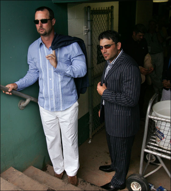 Boston Red Sox pitcher Tim Wakefield, left, and catcher Doug Mirabelli, right, wait in the dugout to be introduced as the makeovers for five Red Sox players were unveilled after a game against the St. Louis Cardinals in Fort Myers, Fla., Wednesday March 16, 2005. Five Red Sox players took part in the show Queer Eye for the Straight Guy