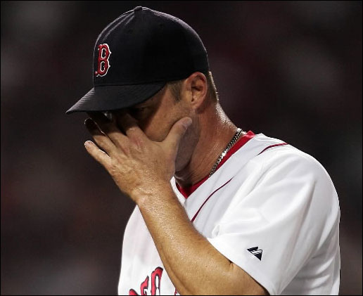 Tim Wakefield #49 of the Boston Red Sox wipes his face as he heads to the dugout after he was pulled out in the fourth inning against the New York Yankees at Fenway Park June 1, 2007