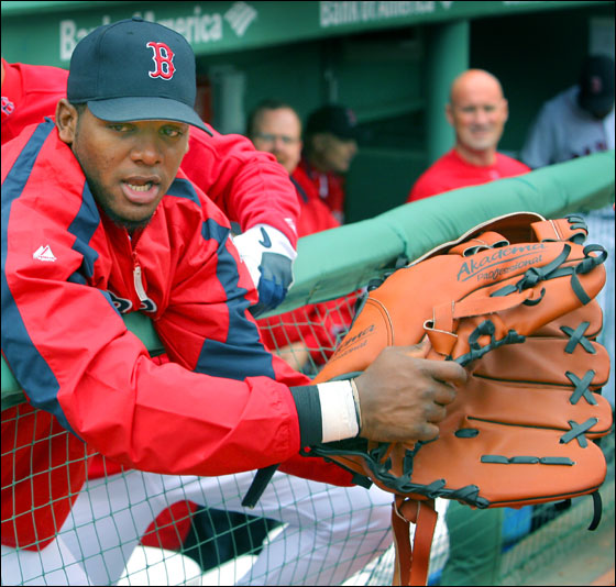 Sometimes defensively challenged Red Sox outfielder Wily Mo Pena may have found a cure for what ails him, a giant glove. Actually, he was trying on an oversized mitt in the dugout before the game that belonged to Boston mascot Wally the Green Monster.