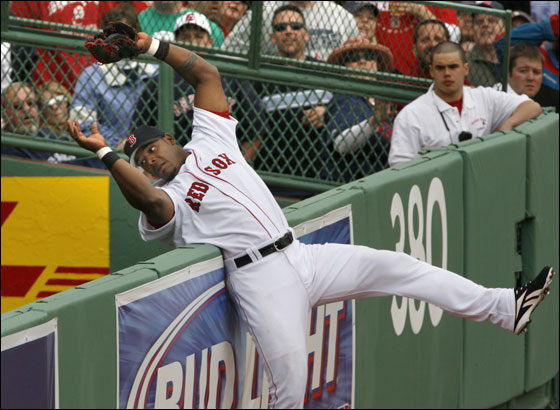 Red Sox Willie Mo Pena cannot come up with the ball as Blue Jays Frank Catalanotto hit a two-run home run durng 8th inning action at the home season opener at Fenway Park on Tuesday