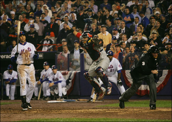 Catcher Yadier Molina #4 of the St. Louis Cardinals reacts after Carlos Beltran #15 of the New York Mets stikes out to end game seven of the NLCS at Shea Stadium on October 19, 2006 in the Flushing neighborhood of the Queens borough of New York City. The Cardinals won 3 to 1.
