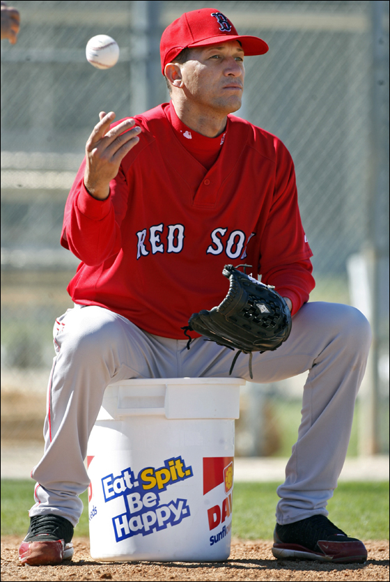 Red Sox reliever Julian Tavarez may have created a minor uproar with his comments regarding the arrival date of teammate Manny Ramirez, but today he was relaxed as he sat on a sunflower seed pail and fed balls too coach Brad Mills who was hitting ground balls to pitchers.