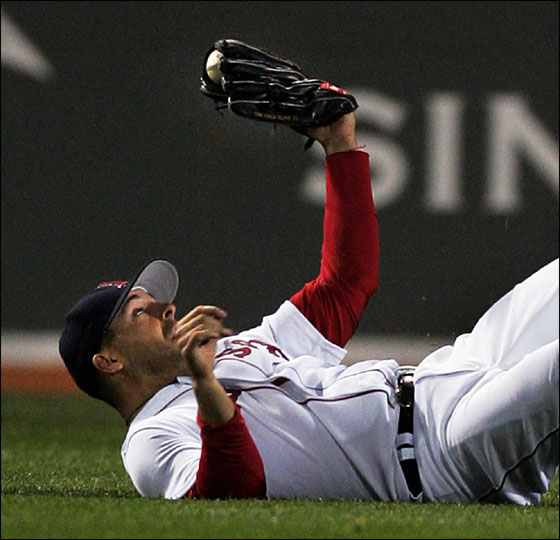 Red Sox center fielder Adam Stern shows the ball in his glove after making a diving catch on a fly ball by Tampa Bay Devil Rays Damon Hollins for the final out in the ninth inning of their baseball game at Fenway Park in Boston Tuesday, April 18, 2006. The Red Sox won, 7-4.