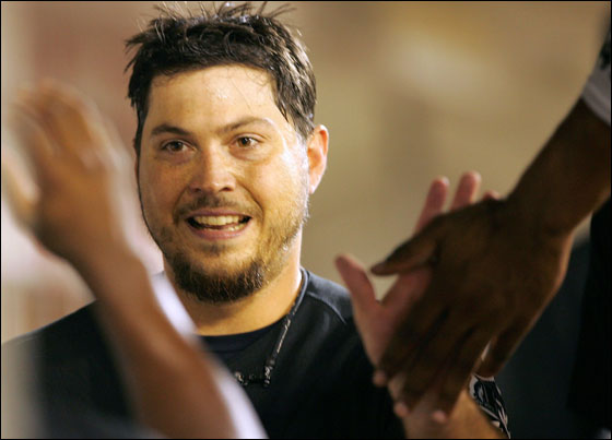 Starting pitcher Josh Beckett, No. 21 of the Florida Marlins, is congratulated in the dugout after hitting a home run during the 5th inning of the game against the Washington Nationals on September 8, 2005 at RFK Stadium in Washington, DC.