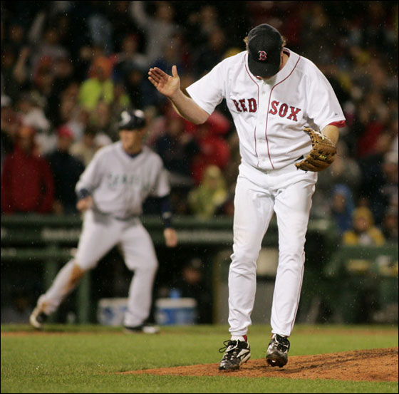 Curt Schilling reacts after striking out Jose Lopez to end the sixth, stranding Seattle's Jeremy Reed (background) at third; Schilling, who allowed three hits and fanned seven, improved to 3-0.